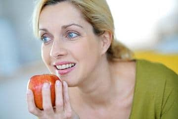 woman-taking-bite-out-of-apple
